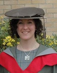 Katie Wheat in graduation gown