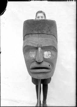Kwakiutl mask and unidentified boy (circa 1920; source: Museum of the American Indian/Heye Foundation)