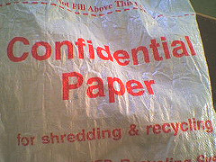 Photo of a large bag labeled 'Confidential Paper for shredding & recycling'.