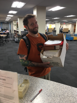Martin Pfeiffer with a box of National Nuclear Security Administration FOIA documents.