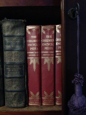 Old volumes of books: Historian's history of the world volume XXIII, and three volumes of Arthur Mee's Children's Encyclopedia