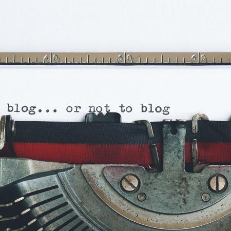 A typewriter. Someone has written 'To blog... or not to blog'.