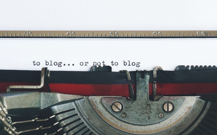 A typewriter. Someone has written 'To blog... or not to blog'.